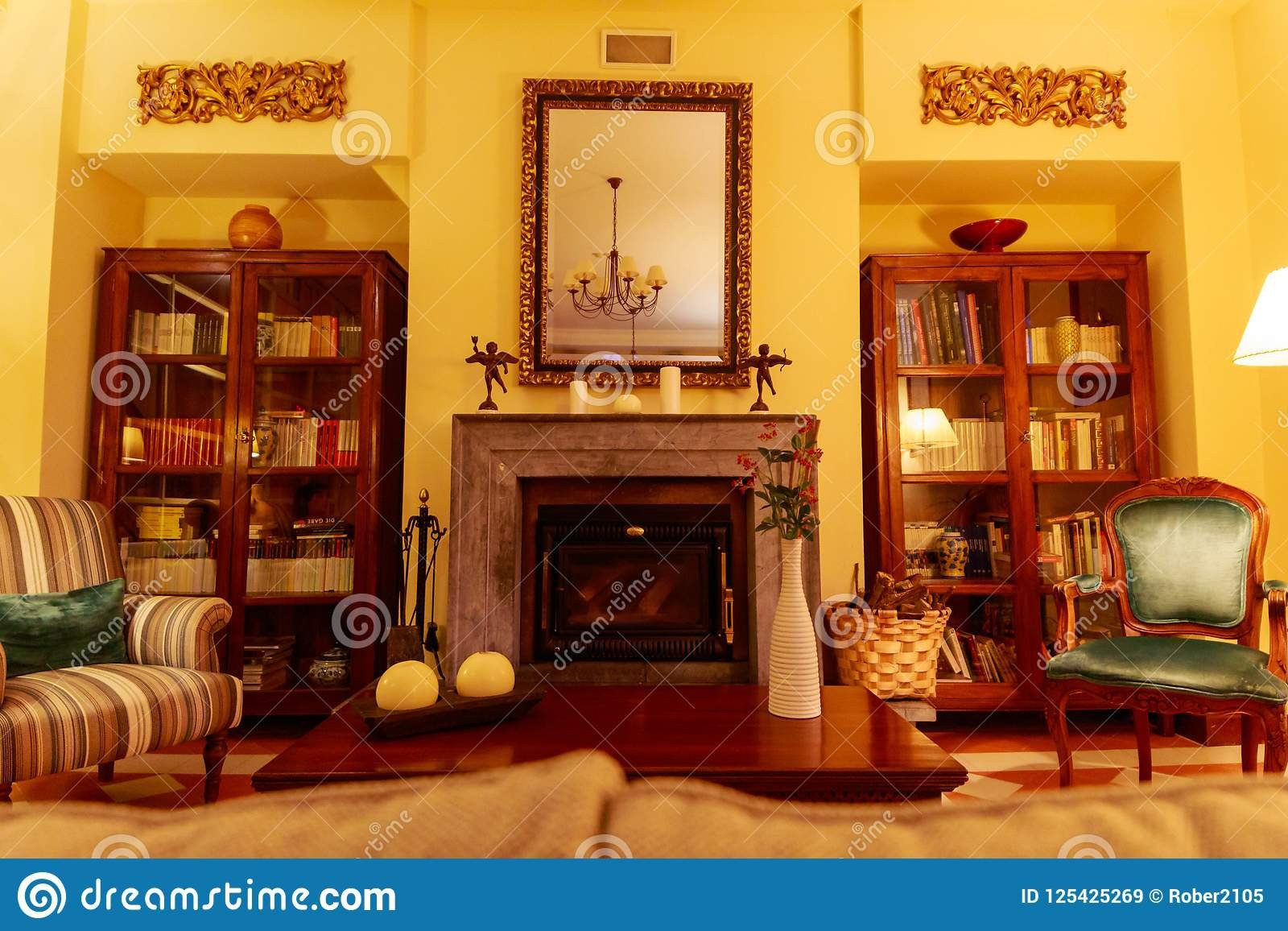 Comfortable Living Room Fireplace Elegant Beautiful and fortable Living Room with A Central Fireplace This is Surrounded by Shelves