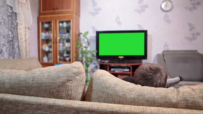 Comfortable Living Roomfor Movie Watching Fresh Young Boy Sitting sofa and Watching Green Screen Tv In Living Room Stock Footage Video