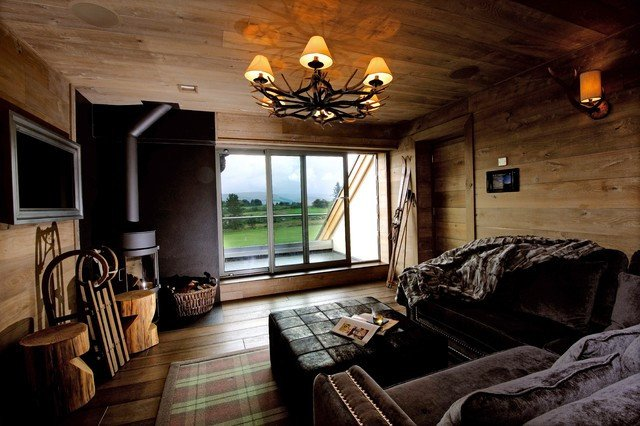 Snug with a cosy feel Wood panelled walls log burner and fortable furnishin Rustic