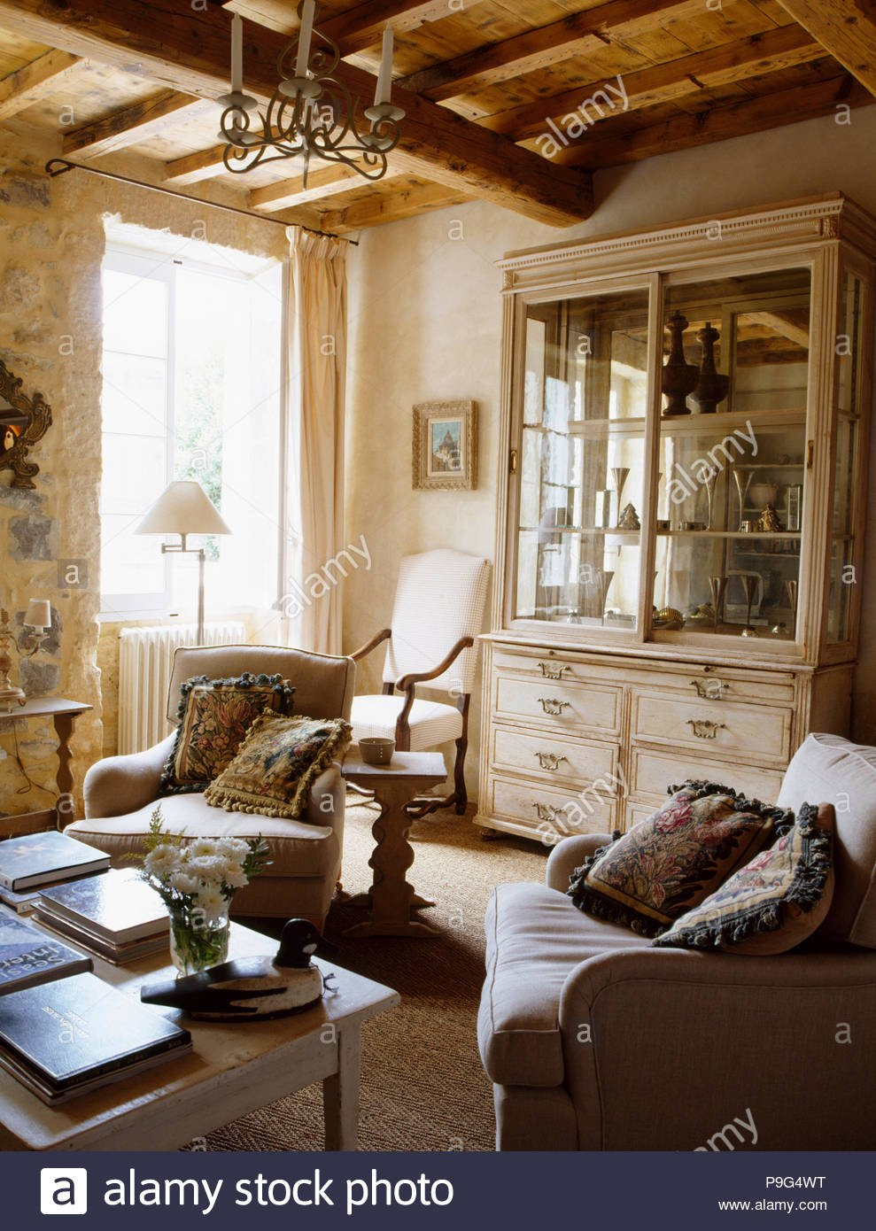 Comfortable Rustic Living Room Lovely fortable Armchairs In French Country Living Room with Glass Fronted Dresser and Rustic Beamed