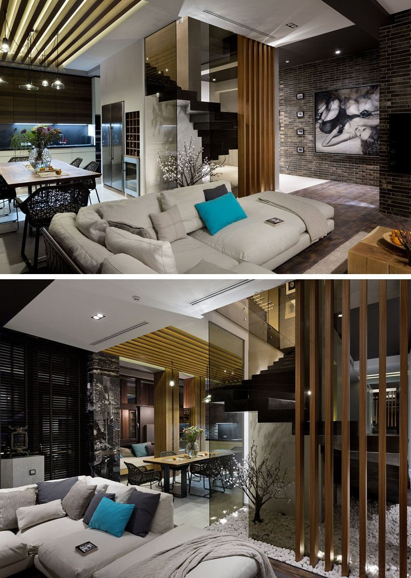 Contemporary Apartment Living Room Beautiful Materials Like Dark Brick Wood and Glass are Used In the Interior Design This Contemporary